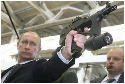 Russian president Vladimir Putin examines new Russian weapon