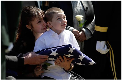 A portrait of a flag-loving mother and son who won't see Dad again